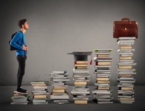 student facing stacks of books