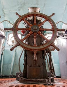 A ship's wheel depicting steering students using performance based assessment.